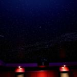 Theater ceiling with night sky mural painting